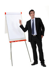 Businessman pointing to a flip chart