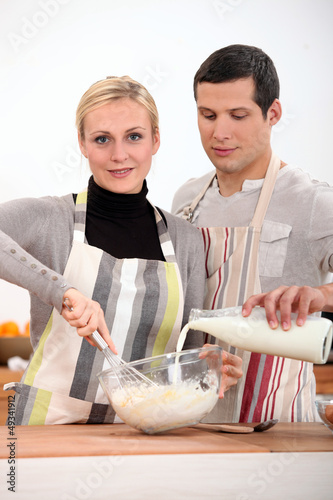 Couple in the kitchen baking