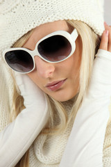 blonde heiress wearing glasses