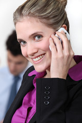 Smiling businesswoman taking on her mobile phone