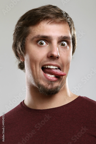 Portrait of young man with silly grimace