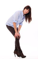Beautiful caucasian woman feels pain in knee