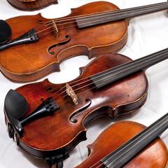 several used violins