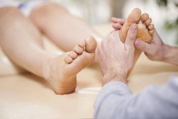Giving a foot rub at a healthy and beauty spa