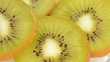 Slices of kiwi rotating.Loop