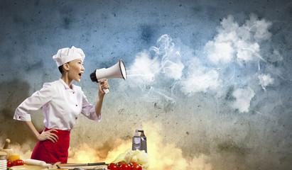 Asian female cook holding megaphone