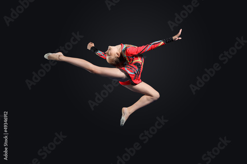 Young woman in gymnast suit posing