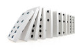 Close up of white dominoes falling over