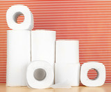 Rolls of toilet paper on striped red background
