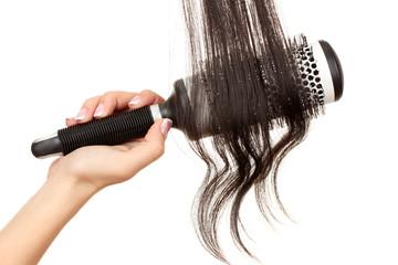 Dark curls brushing comb isolated on white