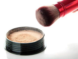 Powder and brush isolated on white
