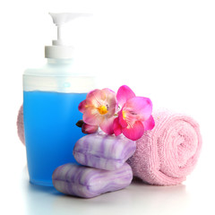 Bottle, soap and towel, isolated on white