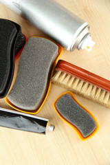 Set of stuff for cleaning and polish shoes, on wooden