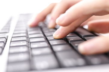 Closeup of  hands typing on computer keyboard