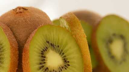Kiwi fruit slices rotating. Loop