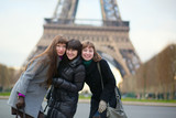 Three friends near the Eiffel tower