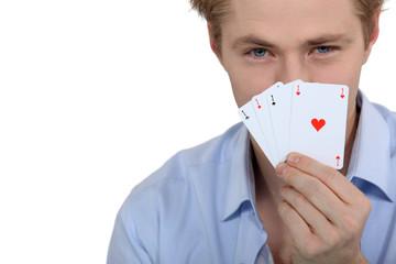 Boy showing poker cards