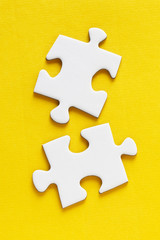 Jig Saw Puzzle - Two Pieces on Yellow