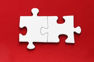 Jig Saw Puzzle - Two Pieces on Red