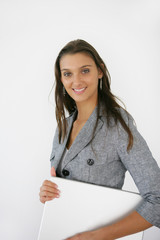 young businesswoman holding her laptop