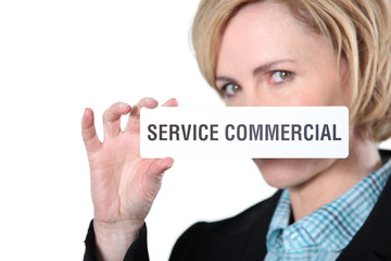 Woman holding commercial servicesign