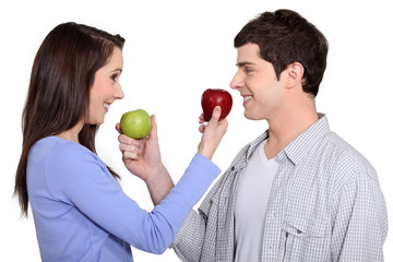 Couple exchanging apples