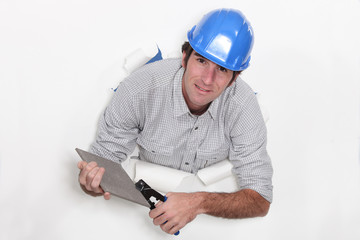 Workman using tile nibblers
