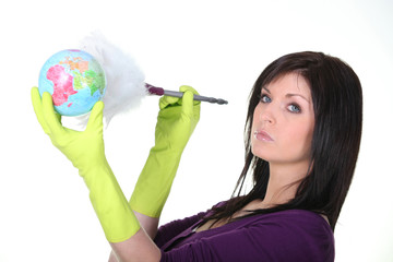 Woman dusting a globe