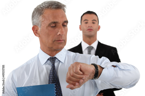 handsome businessman checking his watch