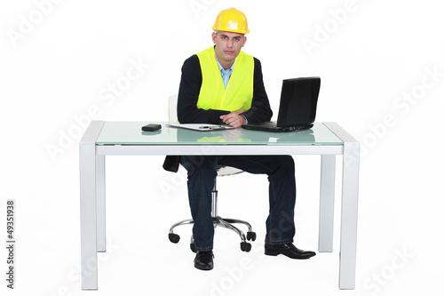 Architect sat by desk