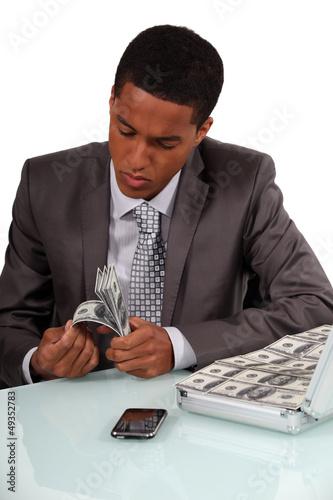 Man counting bank notes