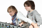 Two boys play table football