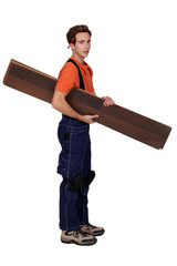 Handyman holding planks isolated on white background