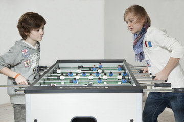 Two boys play table football2