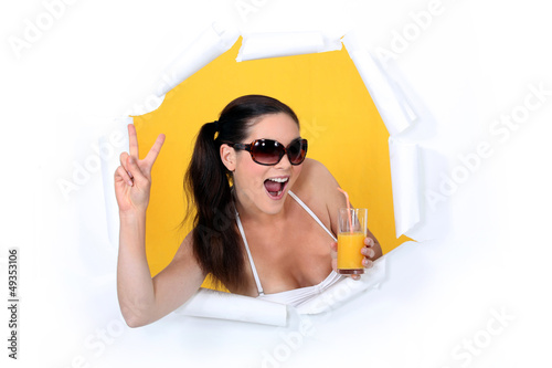 Woman coming out of hole with orange juice