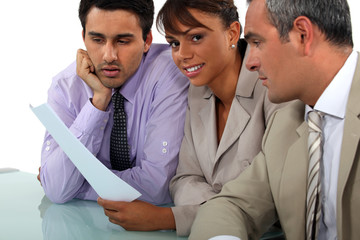 A team of business professionals reviewing a report