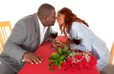 African American Couple About to Kiss in Romantic Dinner