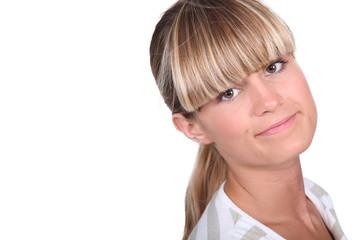 Shy blond female teenager