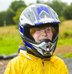 happy boy with helmet at the kart trail