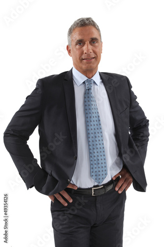 Businessman stood with hands on hips