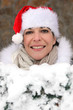 Woman wearing a festive hat whilst in snow