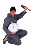 Mechanic with a clock showing noon