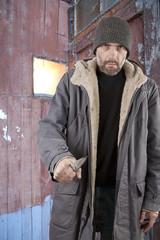 adult man holding knife