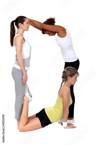 Women making the letter D