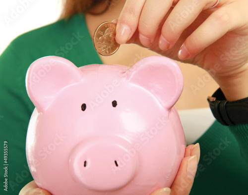 Unknown woman holding  piggy bank (money box)