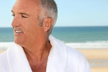Senior man in a bathrobe