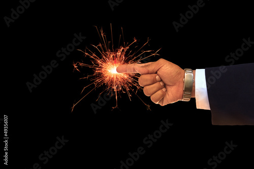 hand of business man pointing on sparking fire