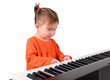 One small little girl playing piano.