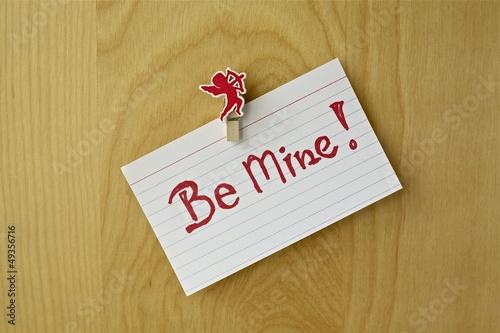 Valentine concept. Message on a wooden background.