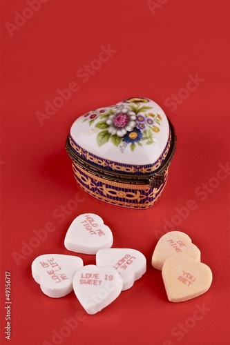Valentine concept. Small metal gift box in the shape of a heart.